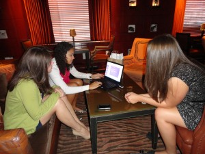 Molly, Larissa, and Lindsay reviewing their presentation in the beautiful lobby of the Clift Hotel in downtown San Francisco.